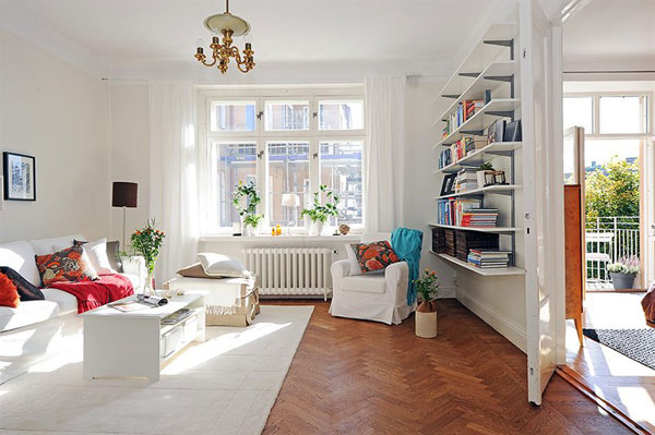 white-interior-design-modern-living-room-with-natural-lighting-from-windows-and-a-small-library